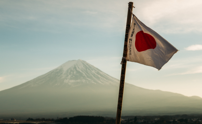 Japanese flag in front of Mt Fuji