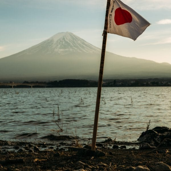 Japanese flag in front of Mt Fuj