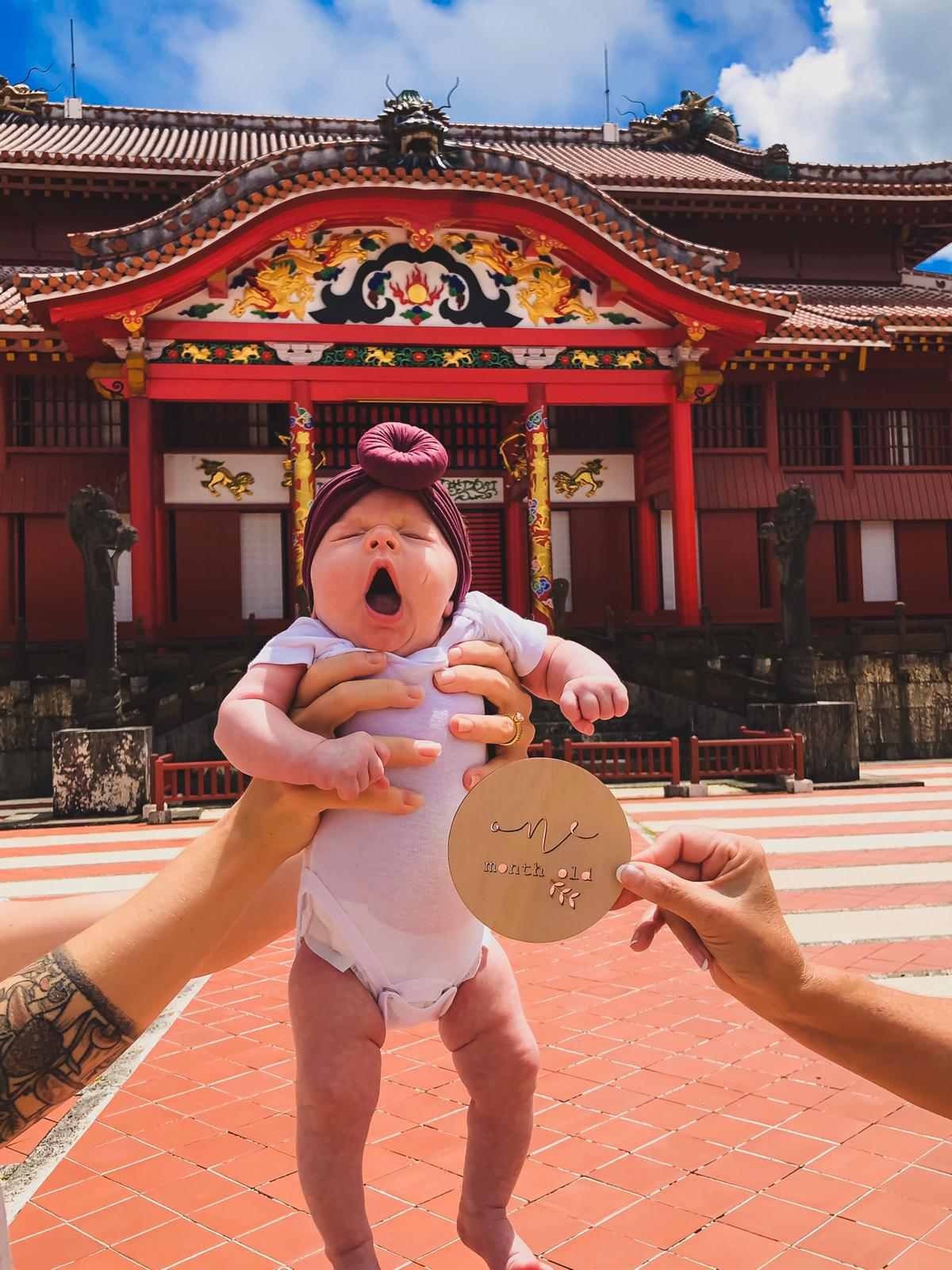 baby infront of shrine