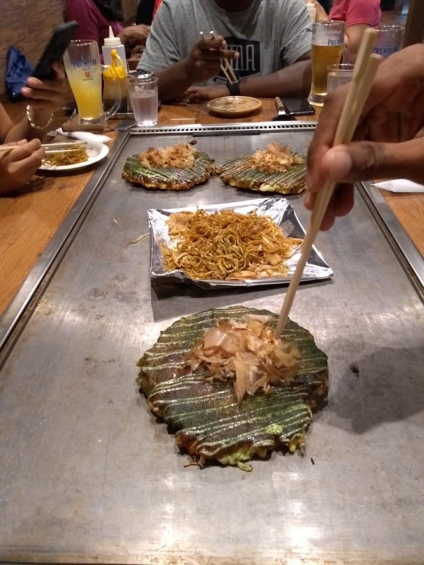 People eating okonomiyaki