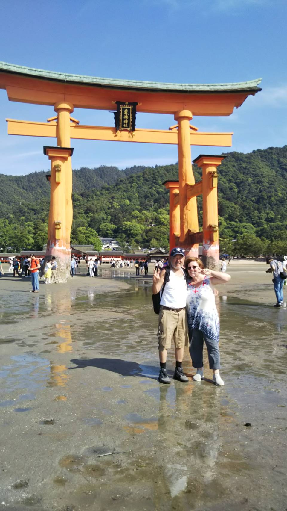 couple posing for photo in miyajima