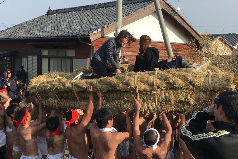 group of men wearing fundoshi carrying women in a basket