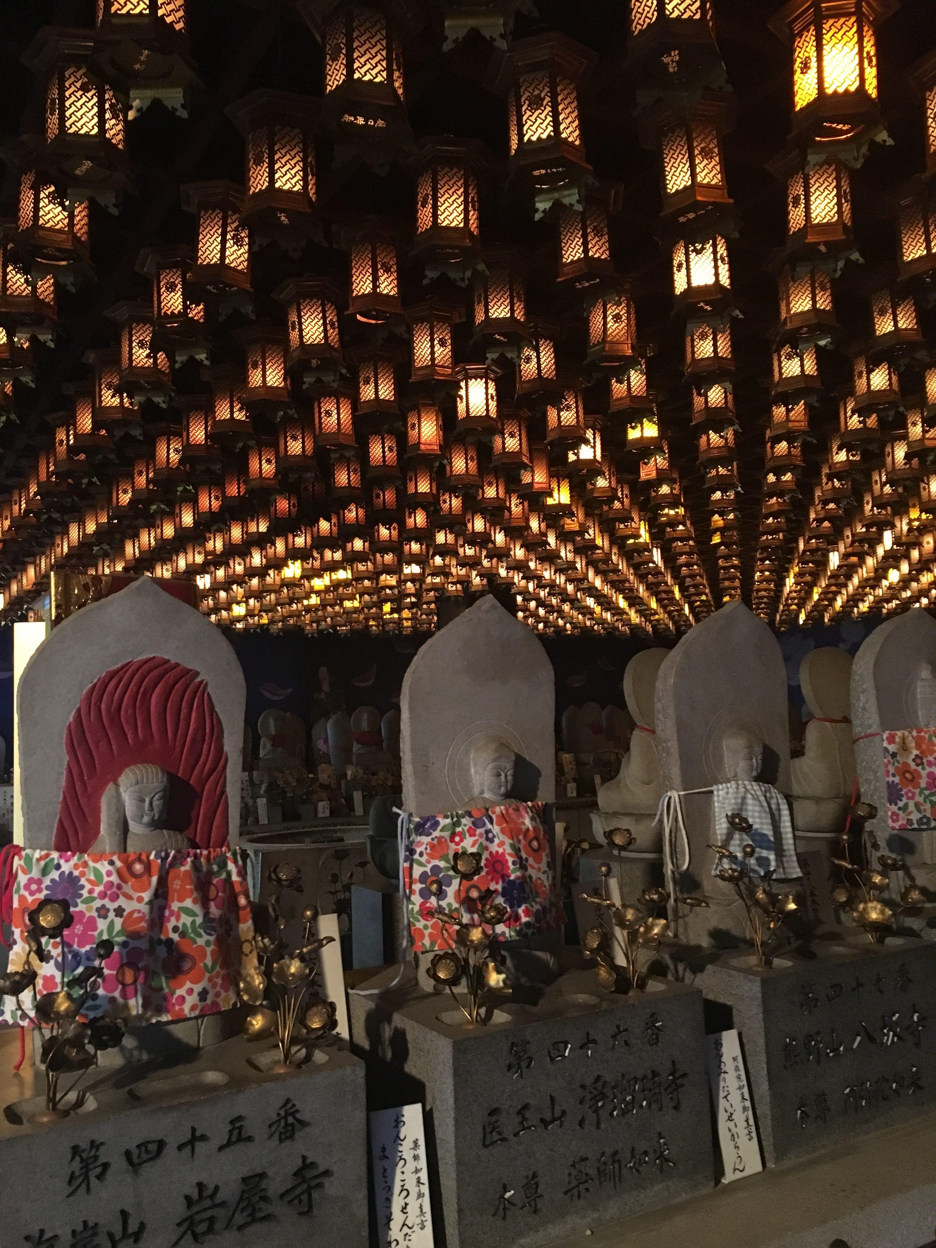 Grave stones with lanterns.