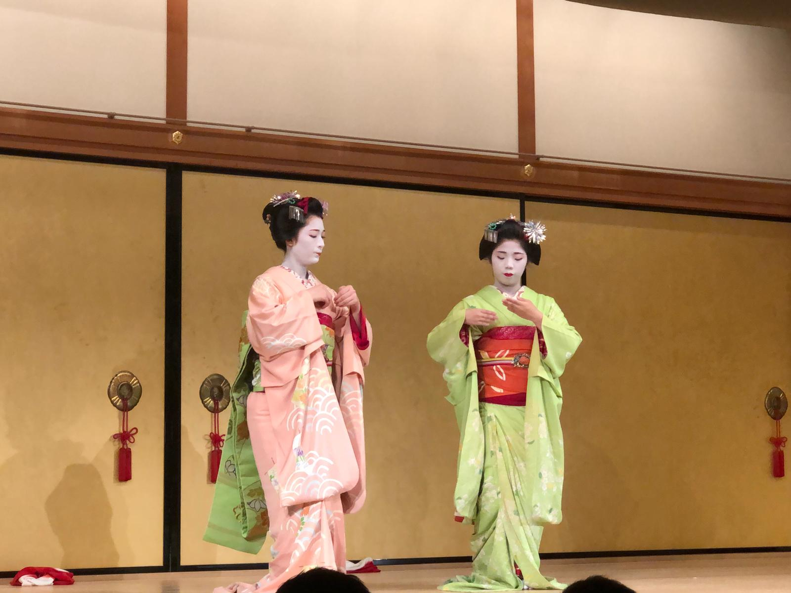 Two geishas performing.