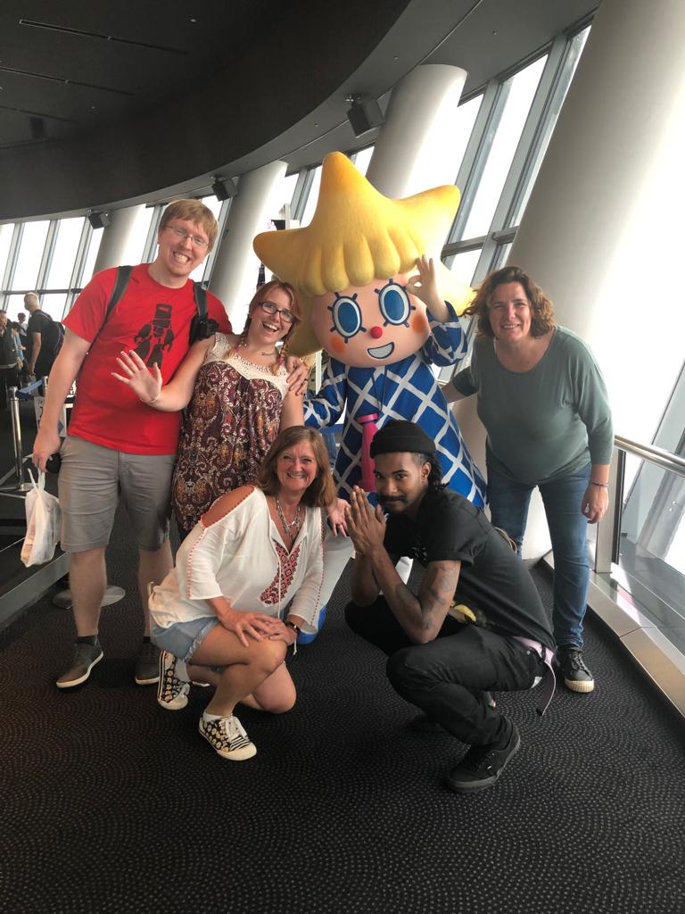people posing with a mascot
