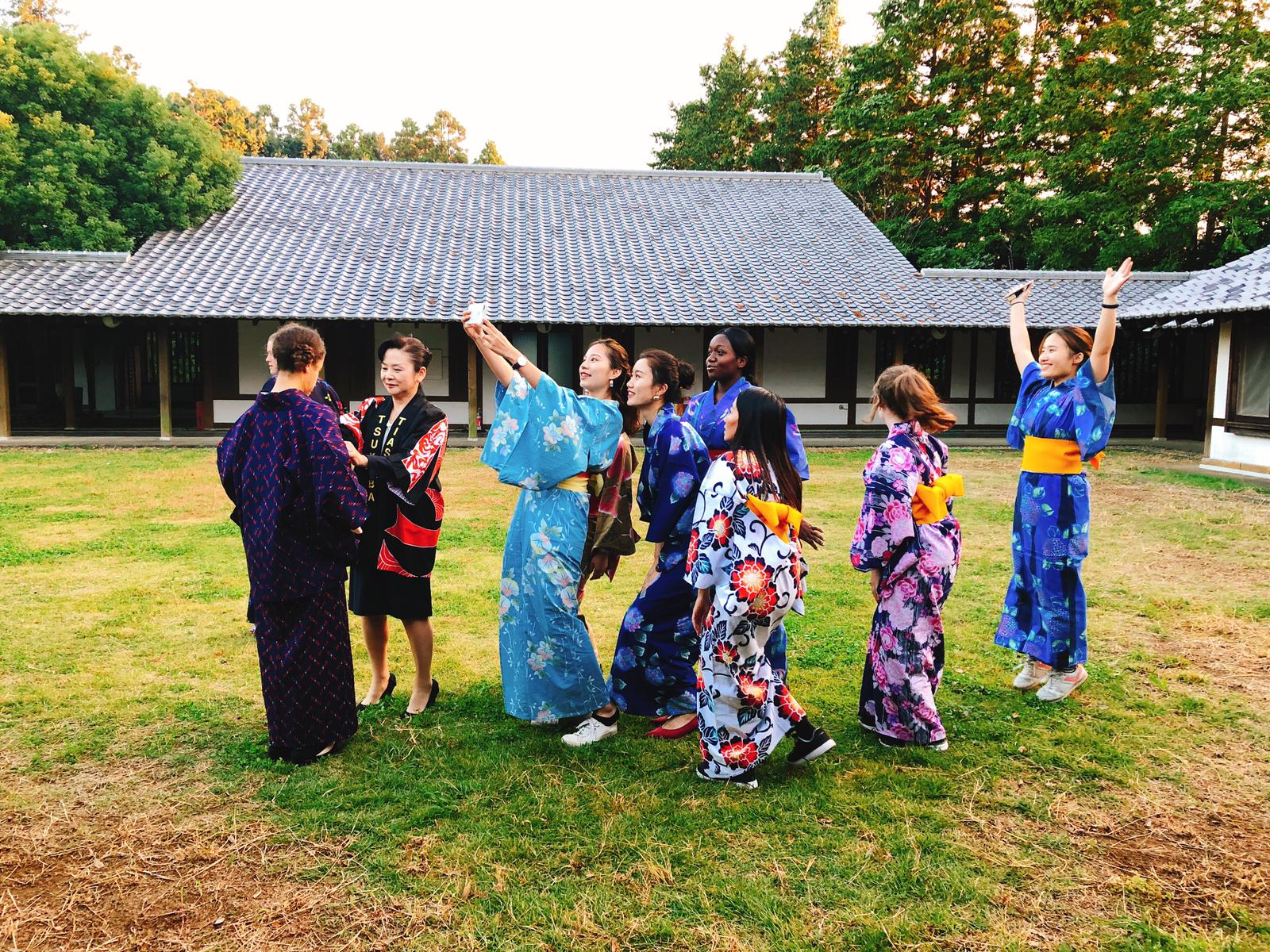 A group of people taking photos in Japanese yukata.