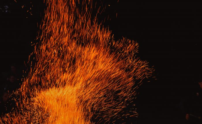 Red sparks from a burning fire.