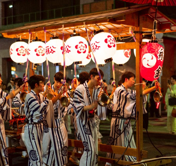 Lanterns and men wearing festival clothes at Gion festival.