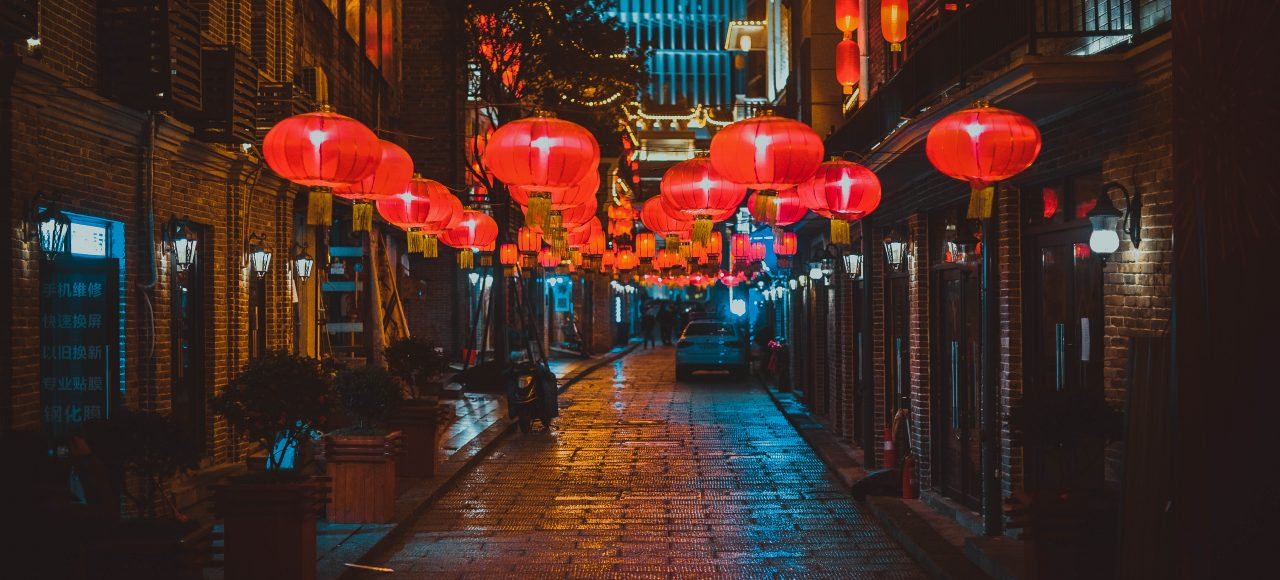 Red lanterns on an empty street in Nagasaki.