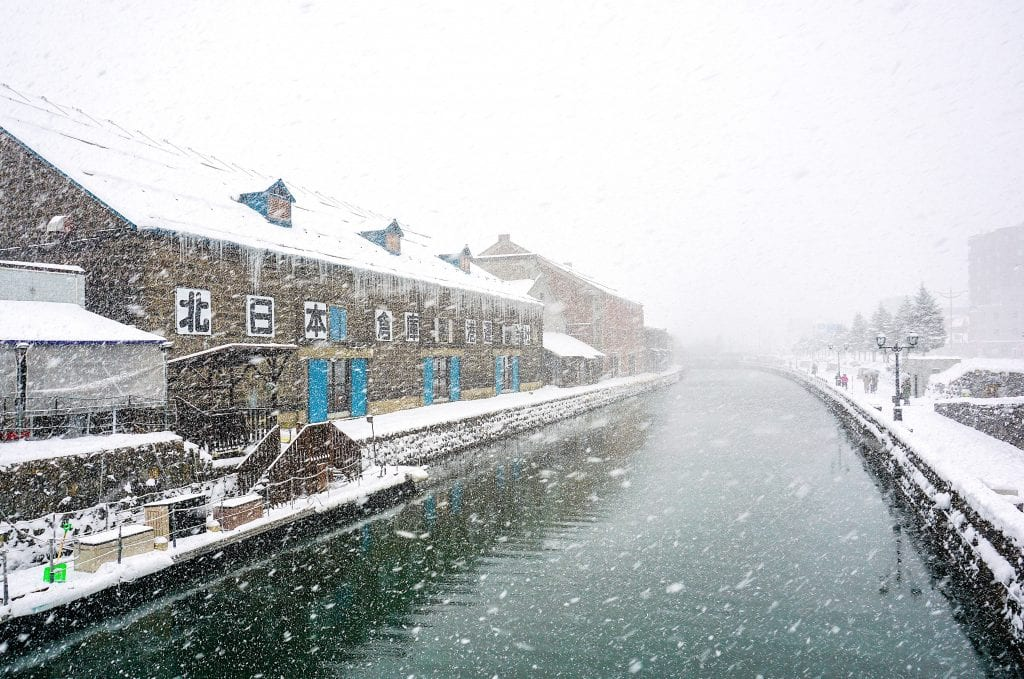 Snow falling over the canal in Otaru.